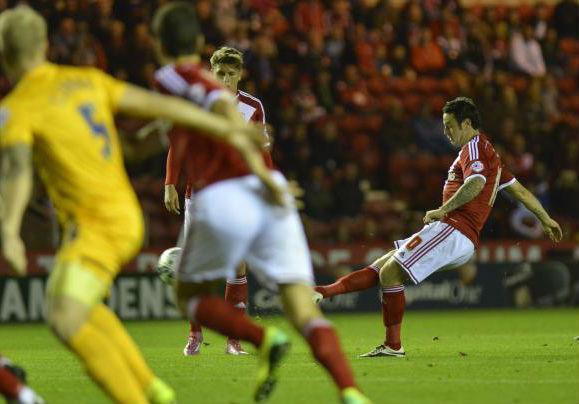 The Advertiser Series: COOL STRIKE: Lee Tomlin curls home the opening goal of Middlesbrough's 3-1 Capital One Cup win over Preston on Tuesday