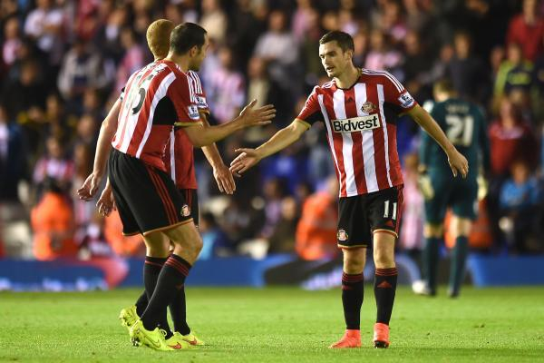 The Advertiser Series: CUP JOY: Adam Johnson, right, celebrates his goal with team-mate John O'Shea during last night's 3-0 Capital One Cup win at Birmingham City