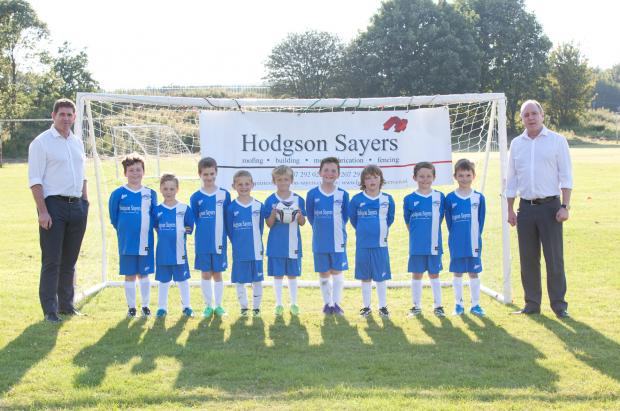 The Advertiser Series: Hodgson Sayers Contracts Manager Colin Howey  (left) and   Managing Director John Sayers (right) with Beamish FC players.