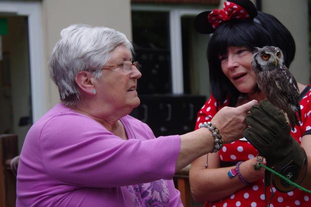 The Advertiser Series: FUN DAY: Resident Ena Johnson, 69, with activities coordinator,