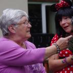 The Advertiser Series: FUN DAY: Resident Ena Johnson, 69, with activities coordinator, Jan Traynor, dressed as Minnie Mouse enjoy the fun of the fair