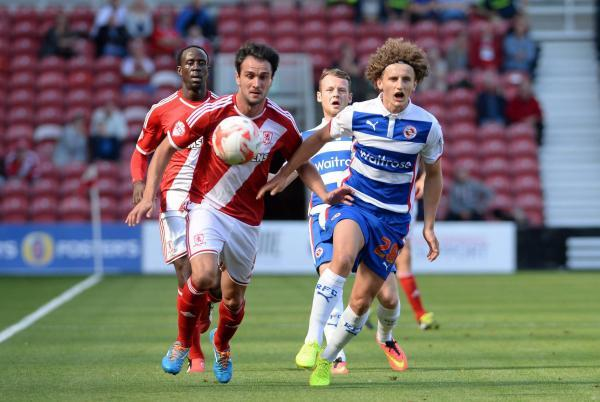The Advertiser Series: FOOT RACE: Boro's Kike races for the ball with Reading youngster Aaron Kuhl during the Teessiders' narrow defeat on Saturday