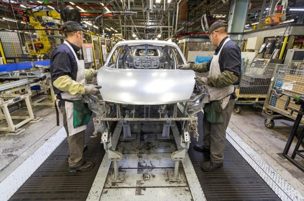 The Advertiser Series: DRIVING FORCE: Nissan workers fit the bonnet to a Juke model at its Sunderland plant