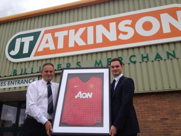 The Advertiser Series: FUNDING GOAL: Jamie Atkinson, sales director of JT Atkinson hands over the Manchester United shirt to event co-organiser Peter Kirkbride