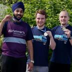 The Advertiser Series: FUNDRIASERS: Staff members Ranjeet Khanda (left), Matthew Welburn and Paul Jackson (right) from Middle Chare Pharmacy in Chester le Street who helped raise money for Alzheimer's Research UK during the Great North Run. Picture: DAVID WOOD (10159811)