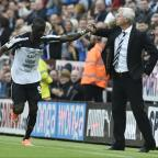 The Advertiser Series: Back in business: Newcastle's Papiss Cisse celebrates his first goal with manager Alan Pardew during the Premier League match at St James' Park PRESS ASSOCIATION Photo.