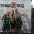 The Advertiser Series: EXTREME OBSTACLES: Nick Flynn (left) with friends, Stephen Cox (centre) and Mark Johnson (right) after finishing a 21km extreme obstacle course to raise money for charity.