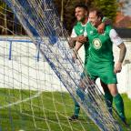 The Advertiser Series: IN FORM: Leon Scott, left, celebrates with Alan White after the defender scored his third goal in as many games. Picture: TIM HICKMAN