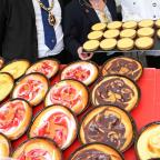 The Advertiser Series: PIE HEAVEN: Durham Mayor and Mayoress John and Maxine Robinson admire the fruit pies made by continental market stallholder Marcin Swierzowski, right.       Picture: ANDY LAMB (11859061)