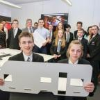 The Advertiser Series: AMAZING: Ben Holliday and Megan Cairns show one of the group's designs with fellow pupils and the FaulknerBrowns and DurhamGate teams in the background